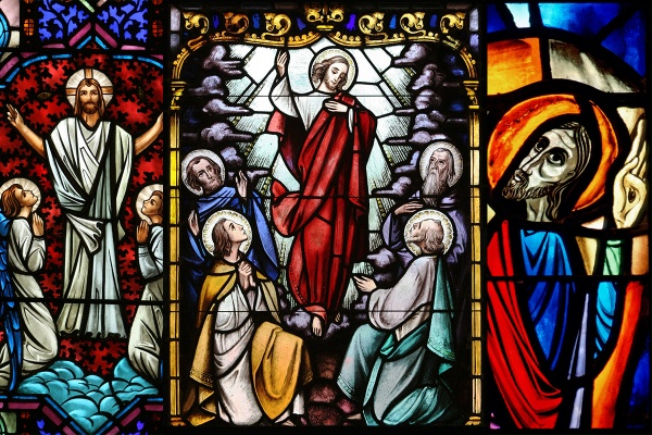 (From left:) Christ's ascent to heaven is depicted in a stained-glass window at 1) St. Clotilde Church in Chicago (Catholic News Service photo/Karen Callaway, Catholic New World); 2) St. Therese of Lisieux Church in Montauk, N.Y (Catholic News Service photo/Gregory A. Shemitz, Long Island Catholic); 3) St. Mary's Basilica in Winnipeg, Manitoba (Catholic News Service photo/Crosiers)